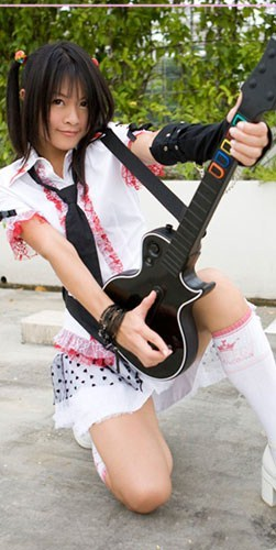Hot girl playing guitar hero